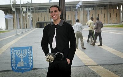 Ohad Shem Tov of the Pirate party wears a fake hook as he poses for a photograph outside the Israeli parliament, December 05, 2012. (Miriam Alster/Flash90)