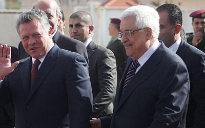 Palestinian Authority President Mahmoud Abbas, right, welcomes King Abdullah II, left, in Ramallah on December 6, 2012. (photo credit: Issam Rimawi/Flash90)