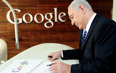Prime Minister Benjamin Netanyahu seen drawing after attending a press conference launching 'Campus TLV' a technology hub for Israeli start-ups, entrepreneurs and developers at Google's Tel Aviv offices Monday, December 10, 2012 (photo credit: Kobi Gideon/Flash90)