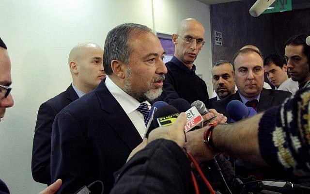 Foreign Minister Avigdor Liberman speaks to reporters as he arrives at the weekly Cabinet meeting at the Prime Minister's Office in Jerusalem on Sunday (photo credit: Alex Kolomoisky/Flash90)