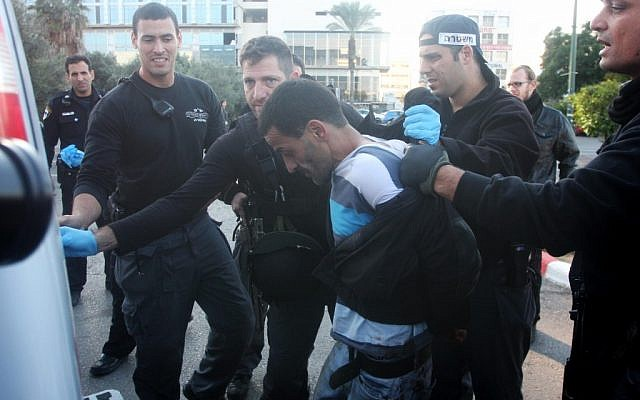 Suspect in the shooting of a security guard at the Elisra Electronic Systems in Bnei Brak arrested in Ramat Gan on Monday morning.(photo credit: Roni Schutzer/Flash90).