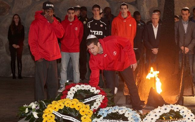 Israeli basketball players visit the Yad Vashem Holocaust memorial on Wednesday, December 19 (photo credit: Isaac Harari/Flash90)