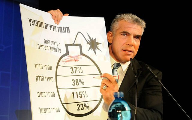 Yesh Atid party leader Yair Lapid presents a diagram mimicking Prime Minister Benjamin Netanyahu's bomb chart that he presented at the United Nations General Assembly in September. (photo credit: Flash90)