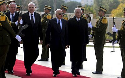 Arab League Secretary General Nabil Elaraby, second right, and Egyptian Foreign Minister Mohammed Kamel Amr, third right, walk past an honor guard upon their arrival in Ramallah Saturday (photo credit: Issam Rimawi/Flash90)