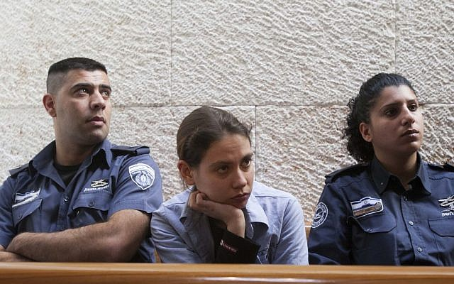 Anat Kamm sits between two Israel Prison Service guards at the Supreme Court in Jerusalem, Monday, December 31, 2012 (photo credit: Yonatan Sindel/Flash90)