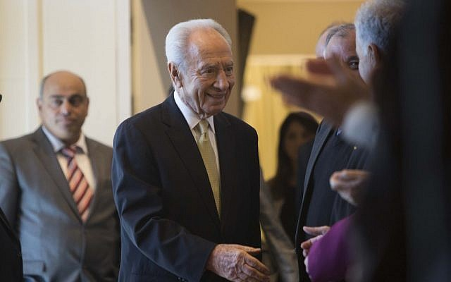 President Shimon Peres greets representatives of the Israeli Christian communities at a ceremony held at the President's Residence in Jerusalem, on December 31, 2012 (photo credit: Yonatan Sindel/Flash90)