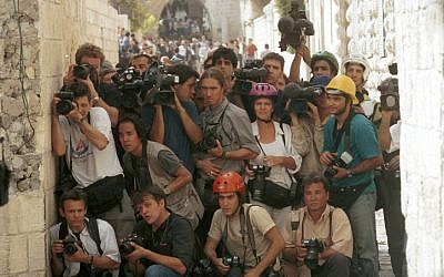 Foreign journalists cover clashes between Israelis and Palestinians in 2000. (photo credit: Nati Shohat/Flash90)