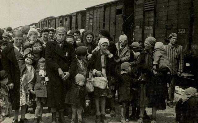 Jewish women and children deported from Hungary, separated from the men, line up for selection on the platform at the Nazi death camp Auschwitz in 1944 (AP/Yad Vashem Photo Archives)