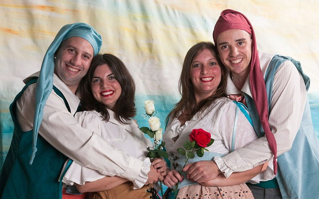 Gondoliers Photo 19 – Daniel Forst (Giuseppe) and Rafi Apfel (Marco) embrace their brides, Maya Cohen (Tessa) and Aviella Trap (photo credit: Brian Negin)