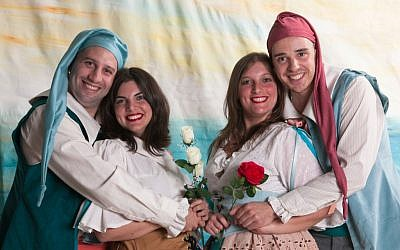 Gondoliers cast members Daniel Forst (Giuseppe) and Rafi Apfel (Marco) embrace their brides, Maya Cohen (Tessa) and Aviella Trapido (photo credit: Brian Negin)