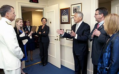 Chuck Hagel, center, speaking to defense officials earlier this year. (photo credit: Sun L. Vega/Department of Defense)