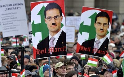 Poster of Hungarian far-right lawmaker Marton Gyongyosi (depicted with a Hitler mustache), at a mass protest against Nazism in Budapest, December 2, 2012 (photo credit: AP/MTI/Laszlo Beliczay)