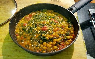 Baby spinach, chickpeas and tomatoes on a base of water-sauteed onions and spices (Courtesy Phyllis Glazer)