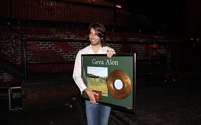 Geva Alon and his newly minted gold record (Courtesy Carmi Wurtman)