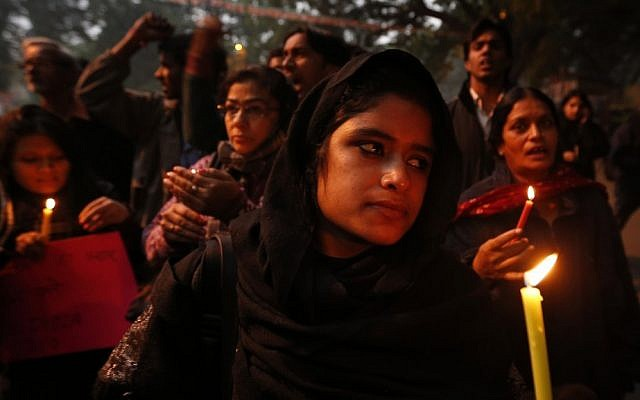 In this Dec. 26, 2012 photo, Indians participate in a candle light vigil to seek a quick recovery of the young victim of the recent brutal gang rape in a bus in New Delhi, India. A statement by Singapore's Mount Elizabeth hospital, where the 23-year-old victim was being treated, said she died Saturday. (photo credit: AP Photo/Saurabh Das)