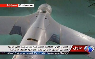 Iranian state TV shows what purports to be an intact ScanEagle drone aircraft, December 4, 2012 (photo credit: AP/Al-Alam TV)