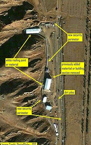 An image released by ISIS, commercial satellite imagery taken December 9, 2012 shows ongoing construction, a new security perimeter, and new roofing on the two major buildings at Iran;s suspected nuclear development site in Parchin (photo credit: AP/ISIS)
