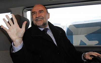 Deputy Director General and Head of the Department of Safeguards of the International Atomic Energy Agency Herman Nackaerts waves as he arrives from Iran at Vienna's Schwechat airport, in Austria, on Friday (photo credit: AP/Ronald Zak)