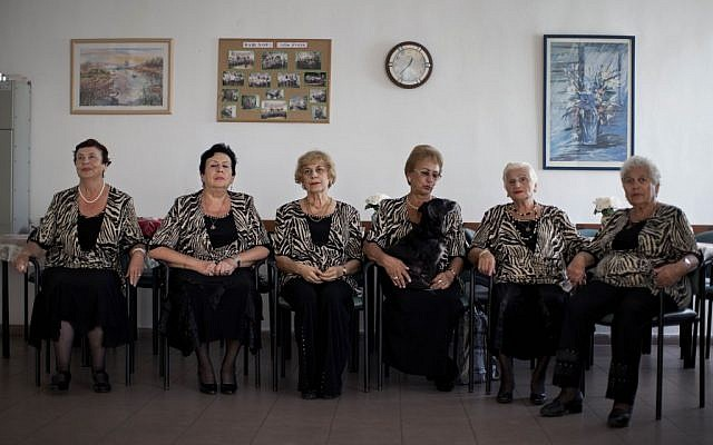 A choir practices in a government-funded elderly care facility catering to Russian-speaking immigrants in Ashdod, southern Israel. The choir sings Russian standards and Israeli folk songs translated into Russian. (photo credit: AP Photo/Oded Balilty)