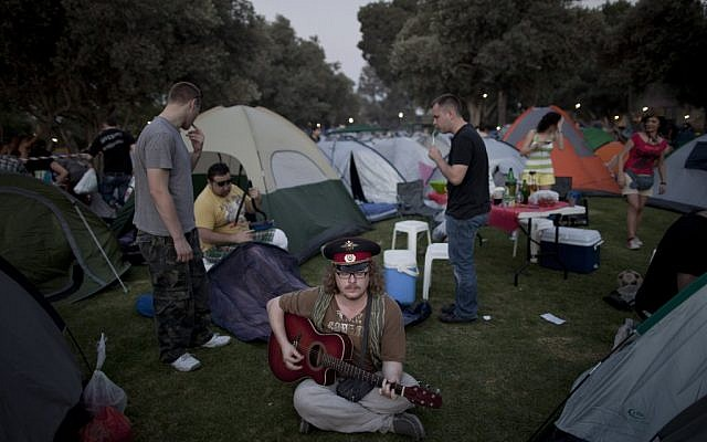 Russian-speaking immigrants gather for a Russian folk music festival in northern Israel. About 2,000 immigrants from the former Soviet Union attended the two-day festival, singing Russian standards, barbecuing and drinking vodka. (photo credit: AP Photo/Oded Balilty)