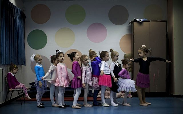 Children of immigrants from the former Soviet Union attend a ballet class in Lod, central Israel. Some prominent ballet dancers left the former Soviet Union for Israel, forming ballet schools and continuing a dance culture highly regarded in their countries of origin (photo credit: AP Photo/Oded Balilty)