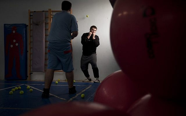 Russian-speaking Israeli immigrants train in a boxing club in Ashdod, a southern city heavily populated by immigrants from the former Soviet Union (photo credit: AP Photo/Oded Balilty)
