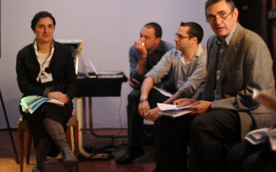 Karen Allali of the Jewish Guides and Scouts of France and Jean-Charles Zerbib (far right), an official of the Unified Jewish Social Fund, speak in Marseille, where Jewish groups are struggling to absorb cutbacks in government funding. (Cnaan Liphshiz via JTA)