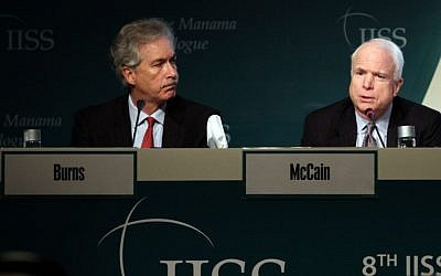 Deputy Secretary of States William Burns, left, and Sen. John McCain, right, answer questions during the International Institute of Strategic Studies (IISS) conference in Manama, Bahrain, in December. (photo credit: AP/Hasan Jamali)