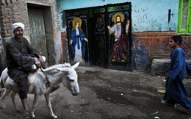 A man rides on a donkey in the village of El-Aziyah near the southern Egyptian city of Assiut on Tuesday. (Illustrative photo: AP/Petr David Josek)