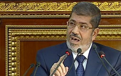 Egyptian President Mohammed Morsi speaks at the Shura Council, the country's upper house of parliament, in Cairo, Saturday, December 29 (photo credit: AP/Egyptian State TV)