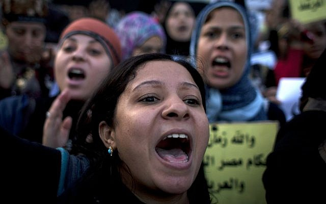 Women protesters opposing Egyptian President Mohammed Morsi chant slogans during a demonstration that started in front of el-Nour mosque, background, in Cairo, Egypt, Tuesday, Dec. 11, 2012 (photo credit: AP/Nasser Nasser)