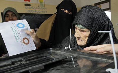 Amnah Sayyed Moussa, 85, casts her vote for the second round of a referendum on a disputed constitution drafted by Islamist supporters of President Mohammed Morsi in Giza, Egypt, Saturday, December 22, 2012 (photo credit:AP/Amr Nabil)