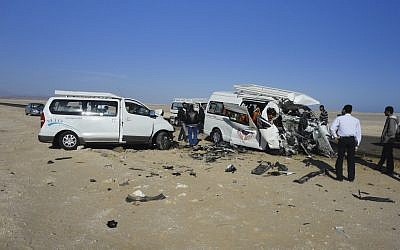 The aftermath of a two-vehicle accident, which left at least five Germans and three Egyptians dead and others injured on the road between Hurghada and Safaga on the Red Sea coast of Egypt on Sunday. (photo credit: AP)