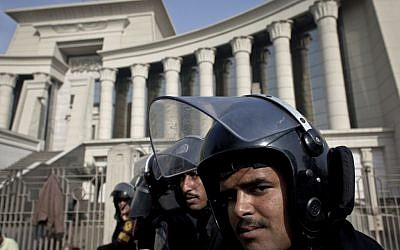 Illustrative photo of riot policemen standing guard in front of Egypt's top court, in Cairo, Egypt, Monday, December 3, 2012 (photo credit: AP/Nasser Nasser)