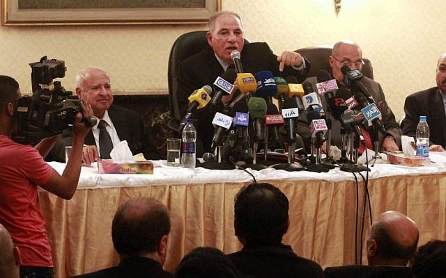Head of the powerful Egypt Judges Club Ahmed el-Zind (center) speaks at a press conference on Sunday, announcing that judges will not oversee the Dec. 15, 2012 referendum to approve a contentious draft constitution in Cairo (photo credit: Ahmed Ramadan/AP)