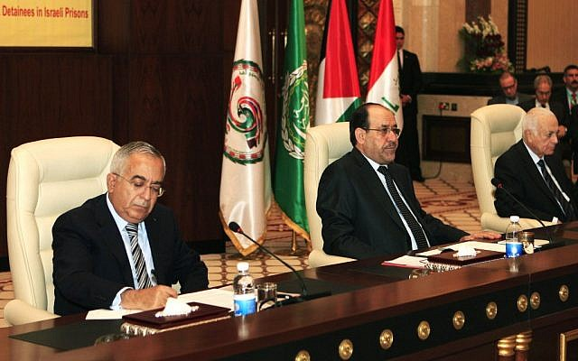 Salam Fayyad (left) Nouri al- Maliki (center) and Nabil Elaraby (right) attend the International conference in solidarity with Palestinian, Arab prisoners and detainees in Israel, in Baghdad last month. (photo credit: AP/Karim Kadim)