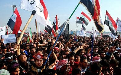 Protesters chant slogans against Iraq's Shiite-led government in Ramadi, 70 miles (115 kilometers) west of Baghdad, Iraq, Sunday, Dec. 30, 2012. (Photo credit: AP)