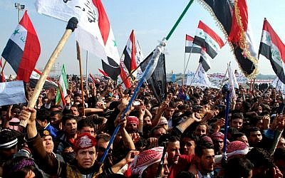 Protesters chant slogans against Iraq's Shiite-led government in Ramadi, 70 miles (115 kilometers) west of Baghdad, Iraq, last December (Photo credit: AP)