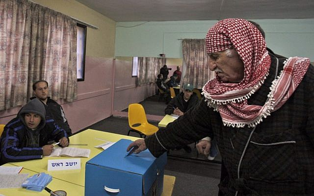 An elderly Israeli Arab man, right, casts his ballot in a polling station in the northern Israeli city of Nazareth, February 10, 2009 (photo credit: AP/Muhammed Muheisen, File)