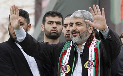 Hamas chief Khaled Mashaal waves to Palestinian Hamas supporters during a rally to commemorate the 25th anniversary of the Hamas terror group, in Gaza city, Saturday, Dec. 8, 2012. (photo credit: AP/Hatem Moussa)