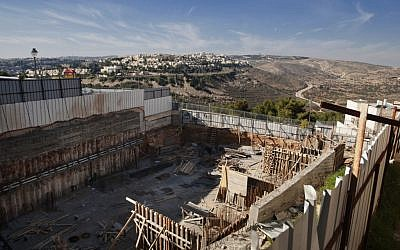 Illustrative photo of a construction site in the East Jerusalem neighborhood of Ramat Shlomo, December 2012 (AP/Dan Balilty)