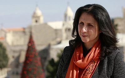"Bethlehem's first female mayor, Vera Baboun is seen in front of the Church of Nativity, traditionally believed by Christians to be the birthplace of Jesus Christ, in the West bank city of Bethlehem. Bethlehem's first female mayor, Vera Baboun, can't walk through the main square of the biblical town without being stopped by admirers. ""This is our new mayor, who is turning Bethlehem into one of the greatest cities in the world,"" a tour guide hollered to a group of Christian tourists passing by the Church of the Nativity, built over the grotto where tradition says Jesus was born. (AP Photo/Majdi Mohammed)"