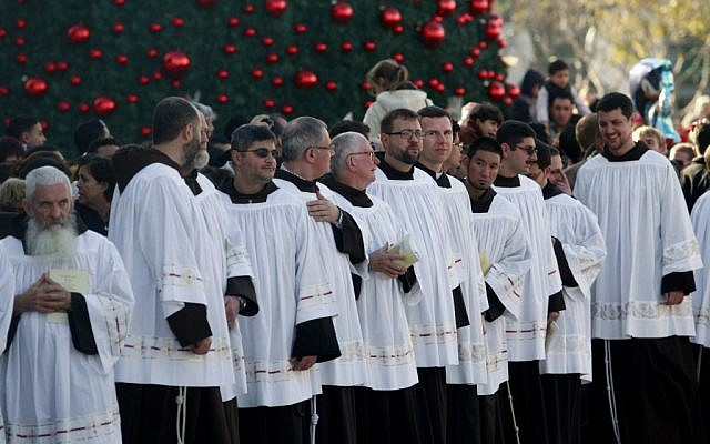 Catholic priests attend Christmas celebrations in the West Bank town of Bethlehem, Monday (photo credit: Nasser Shiyoukhi/AP)