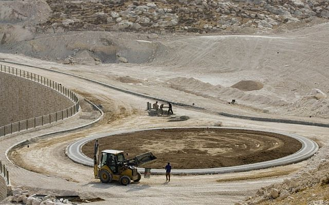 Construction workers are seen at the E-1 construction site near Maaleh Adumim in 2007. (photo credit: Sebastian Scheiner/AP)
