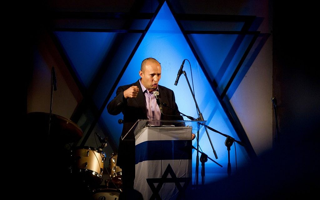Naftali Bennett speaks at a Yeshiva in Ashdod, Tuesday (photo credit: Ariel Schalit/AP)