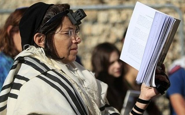 An Israeli member of the Women of the Wall organization prays just outside the Western Wall in Jerusalem's Old City (photo credit: AP/Dan Balilty)