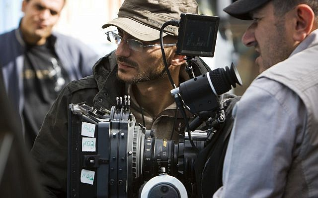 Syrian filmmaker Joud Said, center, works on a film set in Damascus, Syria, in November 2011 (photo credit: AP/Nora Fahham)