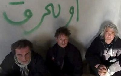 NBC chief foreign correspondent Richard Engel (center), with NBC Turkey reporter Aziz Akyavas (left), and NBC photographer John Kooistra (right), after they were taken hostage in Syria. Undated amateur video posted on the Internet. (photo credit: AP)