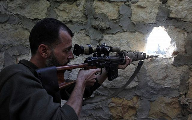 A rebel sniper aims at a Syrian army position on the outskirts of Aleppo last month (photo credit: AP/Khalil Hamra)