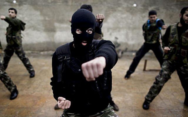 Syrian rebels attend a training session in Maaret Ikhwan, near Idlib, Syria, on Monday, Dec. 17, 2012. (photo credit: Muhammed Muheisen/AP)